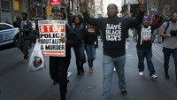 Protesters march with their hands up during a demonstration in the Manhattan borough of New York City calling for social, economic, and racial justice April 29, 2015. Photo: Reuters