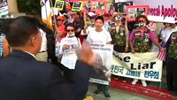 Protesters in LA demonstrate against Japan's PM Abe