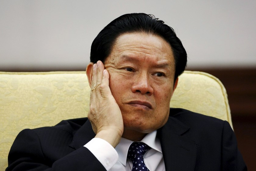 China's former Public Security Minister Zhou Yongkang reacts as he attends the Hebei delegation discussion sessions at the 17th National Congress of the Communist Party of China at the Great Hall of the People, in Beijing in this October 16, 2007 file pho