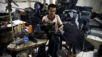 A worker stitches a pair of jeans at a small factory at Cakung industrial village in Jakarta, Indonesia, in this May 5, 2015 file photo.