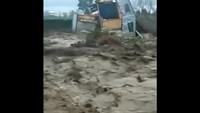 Amateur video captures home swept away in Chile flood water