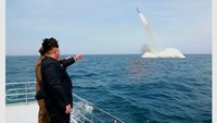 North Korean leader Kim Jong Un watches the test-fire of a strategic submarine underwater ballistic missile, in this undated photo released by North Korea's Korean Central News Agency (KCNA) in Pyongyang on May 9, 2015.