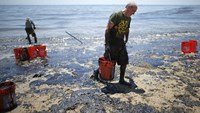 Crews work to clean California beach fouled by oil pipeline spill