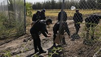 Mexican officials look for clues at ranch of cartel shootout