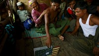 Rohingya 'boat people' tell of harsh treatment at sea