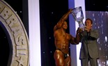 Arnold Schwarzenegger presents trophy to Egyptian bodybuilder