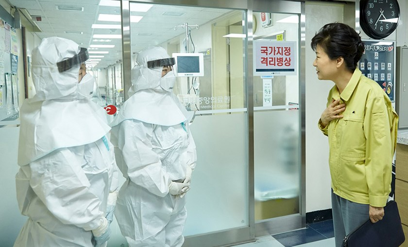 South Korean President Park Geun-hye talks with health care workers in full protective gears during her visit to the National Medical Center housing MERS patients in this picture provided by the Presidential Blue House and released by Yonhap in Seoul