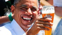 U.S. President Barack Obama toasts with beer as he visits Kruen, southern Germany, June 7, 2015. Photo: Reuters
