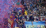 Barcelona fans celebrate their side's treble win