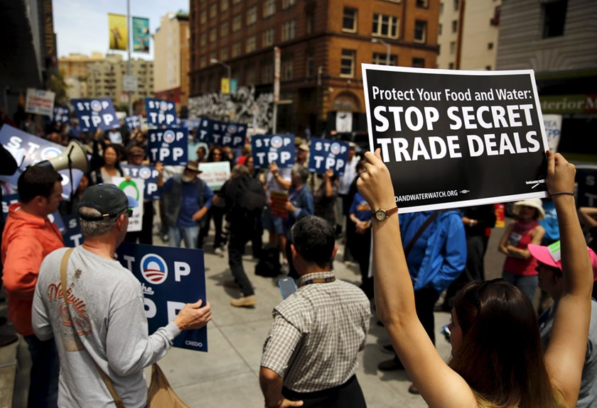 A group of demonstrators protesting the Trans-Pacific Partnership gather at the Federal Building in San Francisco, California June 9, 2015. Photo: Reuters