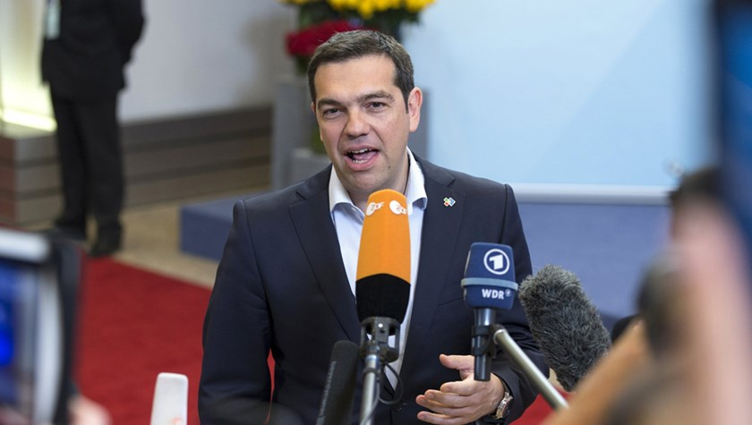 Greek Prime Minister Alexis Tsipras holds a statement while leaving the European Council headquarters on the first day of an EU-CELAC Latin America summit in Brussels, Belgium June 11, 2015. Photo: Reuters