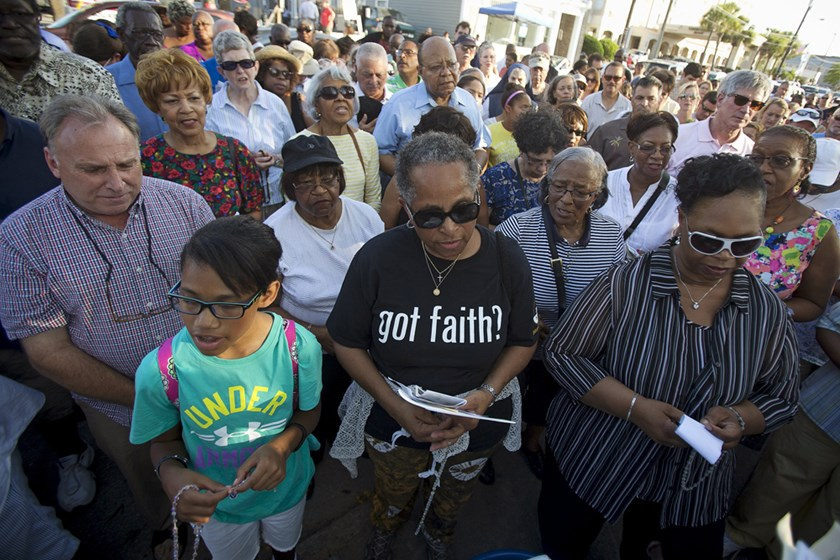 People gather to pray in the late afternoon outside the Emanuel African Methodist Episcopal Church in Charleston, June 21, 2015.  Photo: Reuters