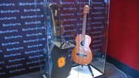 James Bond gun and Chris Martin's first guitar go under the hammer
