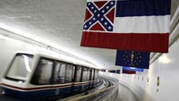 The Mississippi state flag, which incorporates the Confederate battle flag, hangs with other state flags in the subway system under the U.S. Capitol in Washington in this June 23, 2015, file photo. Photo: Reuters