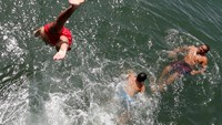 French and Belgians try to keep cool as Europe scorches