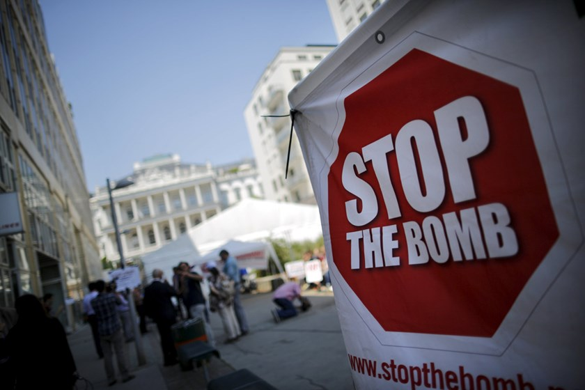 A sign which reads 'Stop the Bomb' is seen as protesters gather outside the hotel where the Iran nuclear talks meetings are being held in Vienna, Austria, July 1, 2015. Photo: Reuters