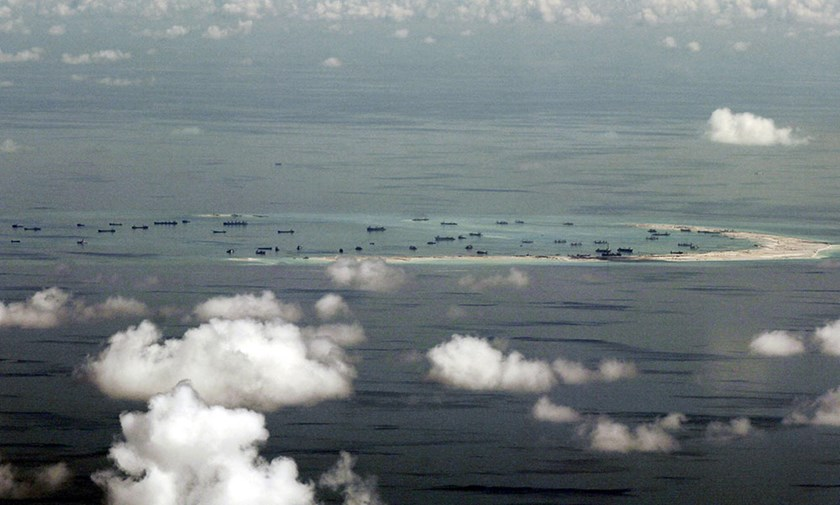 An aerial file photo taken though a glass window of a Philippine military plane shows the alleged on-going land reclamation by China on Mischief Reef in the Spratly Islands in the South China Sea, west of Palawan, Philippines, May 11, 2015. REUTERS/Ritchie B. Tongo/Pool/Files