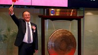 Liu Chuanzhi, Chairman of Legend Holdings, reacts after hitting the gong during the debut of the company at Hong Kong Exchanges in Hong Kong, China June 29, 2015. Shares in China's Legend Holdings Corp rose slightly on debut on Monday after the parent of the world's biggest PC maker Lenovo Group raised $1.96 billion in an initial public offering. Photo: Reuters