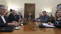 Greek PM arrives for a meeting with political party leaders