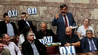 Greek parliament votes in favor of bailout plan