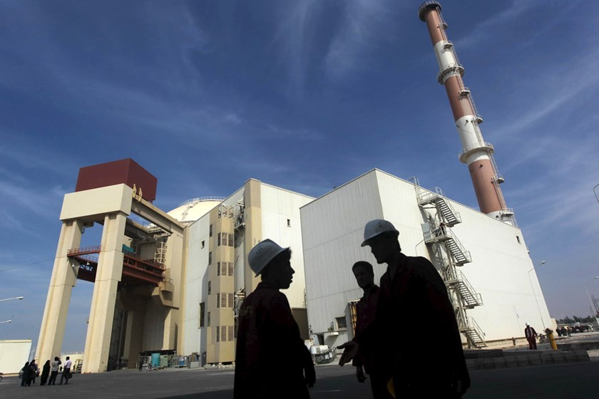 Iranian workers stand in front of the Bushehr nuclear power plant in Iran in this October 26, 2010 file photo. Photo: Reuters