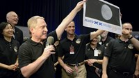 Pluto probe survives encounter, phones home