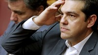 Greek Prime Minister Alexis Tsipras (R) reacts as he sits next to Finance Minister Euclid Tsakalotos during a parliamentary session in Athens, Greece July 16, 2015. REUTERS/Christian Hartmann
