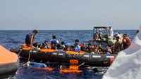 Surviving migrants are brought aboard Irish and Italian Navy life-boats in the area where their wooden boat capsized and sank off the coast of Libya August 5, 2015. Photo: Reuters/Marta Soszynska/MSF/Handout via Reuters