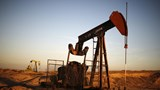 Oil falls below $40, supply glut grows