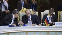 Putin says Russia will continue aid to Assad