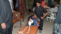 Suicide bomber kills 16 at procession for Shi'ite holiday in Pakistan