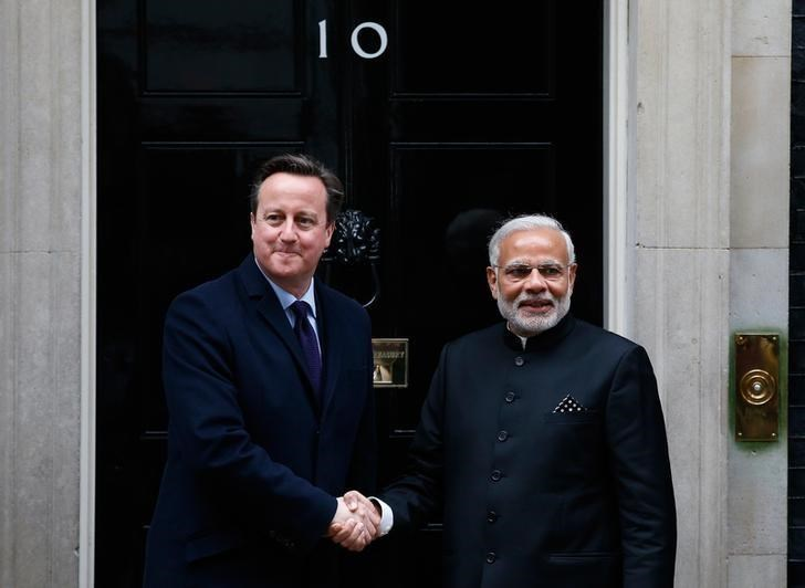 Prime Minister Narendra Modi's is greeted by Britain's Prime Minister David Cameron outside 10 Downing Street, in London, November 12, 2015.