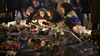 A week later, 'no words' describe pain of Paris carnage