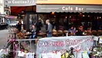 A show of suppport as cafe reopens in Paris