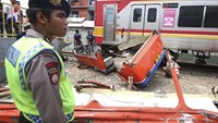 At least 18 dead in Jakarta bus, train crash