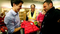First planeload of Syrian refugees arrives in Canada