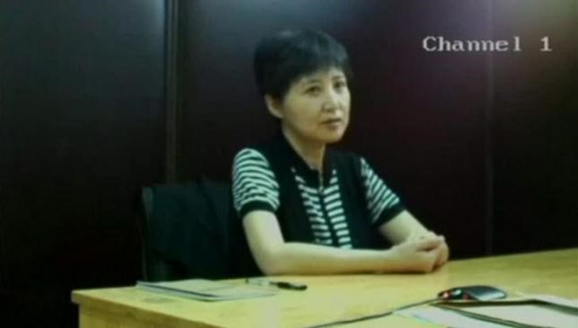 Gu Kailai, wife of Bo Xilai, former Chongqing Communist Party chief, speaks in this still image taken from an August 10, 2013 video provided by the Jinan Intermediate People's Court, recorded at an unknown location and screened on August 23, 2013 in court during Bo's trial...