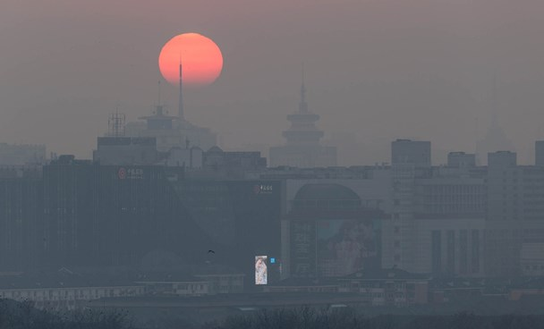 """Beijing engulfed in smog on December 17. Pollution levels in the cities of Beijing, Tianjin and parts of the neighboring provinces of Hebei and Henan will rise Saturday and may hit """"severe"""" levels on December 22. Xiao Lu Chu/Getty Images"""