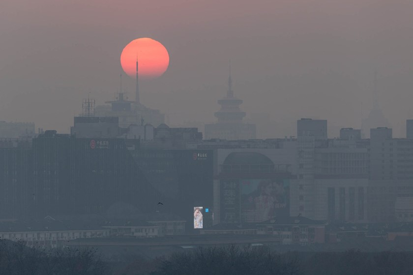 "Beijing engulfed in smog on December 17. Pollution levels in the cities of Beijing, Tianjin and parts of the neighboring provinces of Hebei and Henan will rise Saturday and may hit ""severe"" levels on December 22. Xiao Lu Chu/Getty Images"