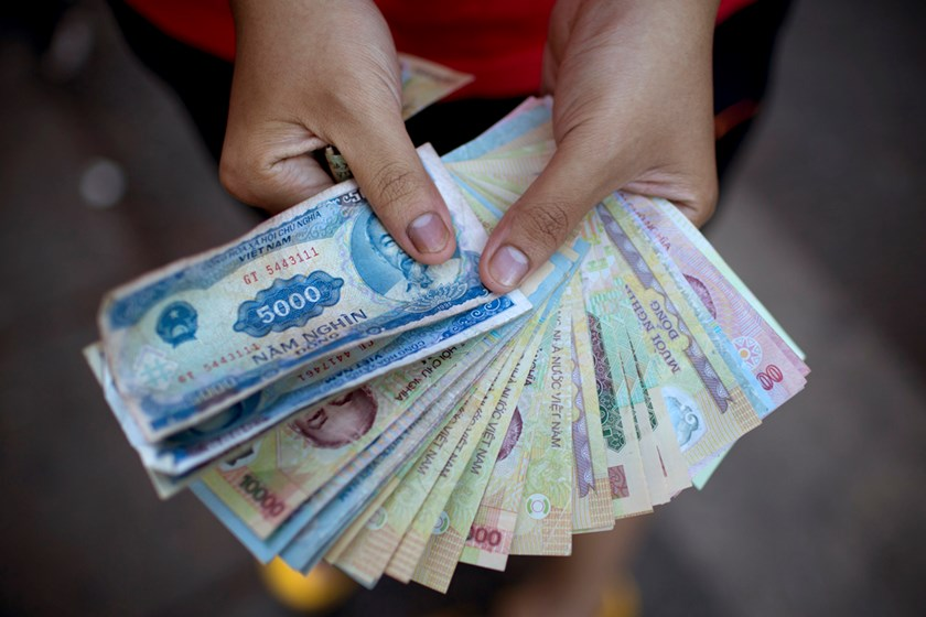 A Man Displays Vietnamese Dong Banknotes For An Arranged Photograph In Hanoi Vietnam On