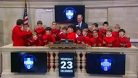 Boy's choir lifts spirits on Wall Street