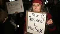 A woman holds a sign during a demonstration in the German city of Cologne on January 5, 2016. AFP/Oliver Berg