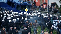 German police spray anti-migrant protesters, Merkel toughens tone