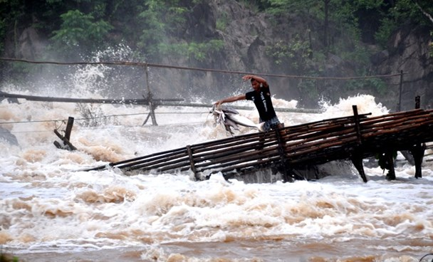 A man fishing in the Khone Falls area, near the site of the Don Sahong dam project. Photo credit: International Rivers