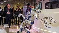 HUBO, a multifunctional walking humanoid robot performs a demonstration of its capacities next to its developer Oh Jun-Ho, Professor at the Korea Advanced Institute of Science and Technology (KAIST) during the annual meeting of the World Economic Forum (WEF) in Davos, Switzerland January 20, 2016. Photo: Reuters/Ruben Sprich