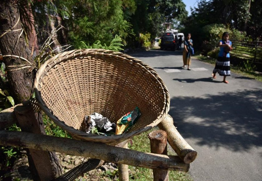 In Mawlynnong, bamboo dustbins stand at every corner, volunteers sweep the streets at regular intervals and large signs order visitors not to litter. Photo: AFP/Biju Boro