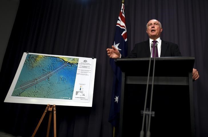 Australia's Deputy Prime Minister Warren Truss speaks during a media conference next to a map displaying the search area for missing Malaysia Airlines Flight MH370 at Parliament House in Canberra, Australia, December 3, 2015. REUTERS/Lukas Coch/AAP