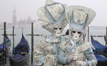 Revellers show off their masks in Venice Carnival