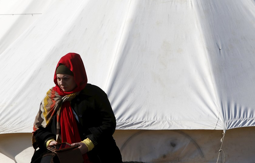 An Iraqi migrant sits outside a tent at a makeshift camp near the village of Moria on the Greek island of Lesbos, January 29, 2016. REUTERS/Darrin Zammit Lupi