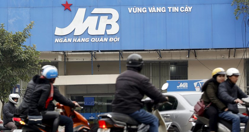Motorcyclists ride past a branch of the Military Commercial Bank in Hanoi, Vietnam, February 18, 2016. REUTERS/Kham